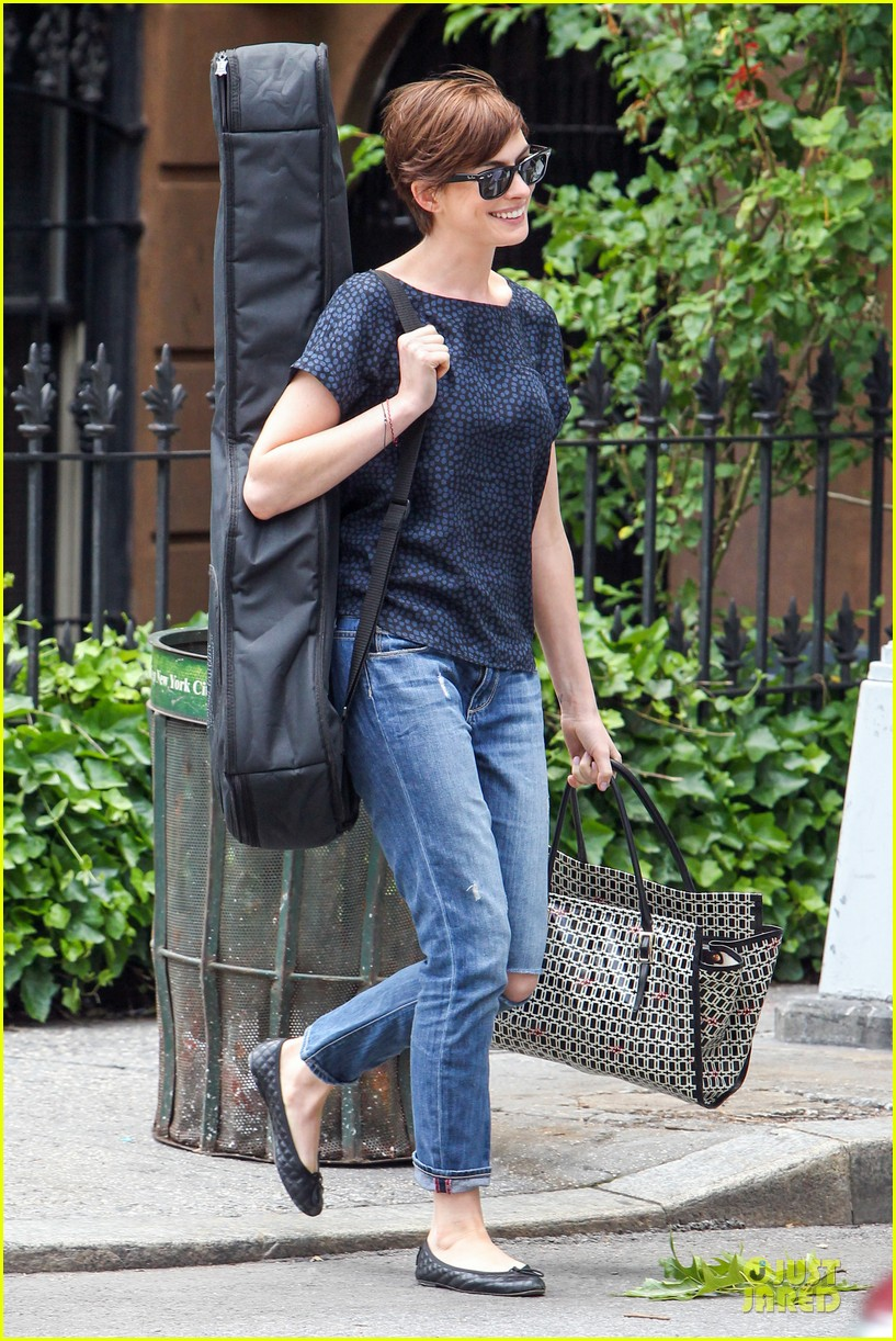 anne hathaway guitar carrying gal on song one set 142890158