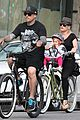 pink carey hart bike riding with willow 17