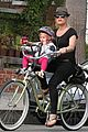 pink carey hart bike riding with willow 19