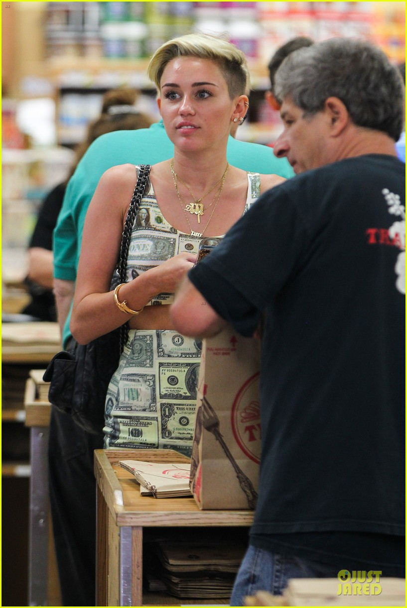 miley cyrus bares midriff with money dress 242908640