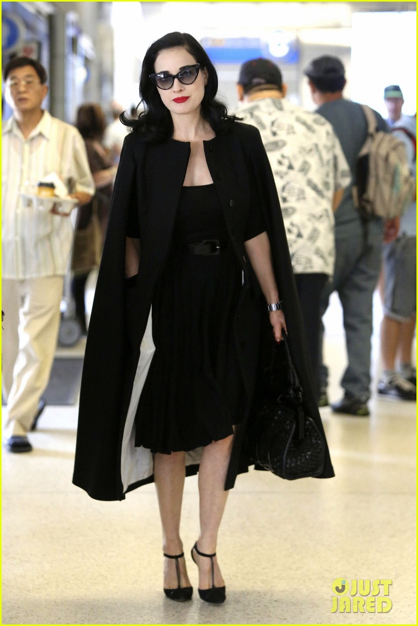 dita von teese wears cape for flight to buenos aires 01