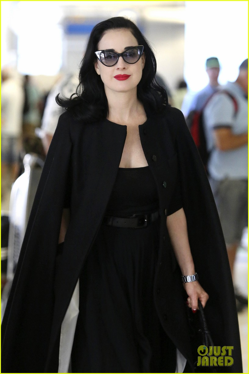 dita von teese wears cape for flight to buenos aires 02