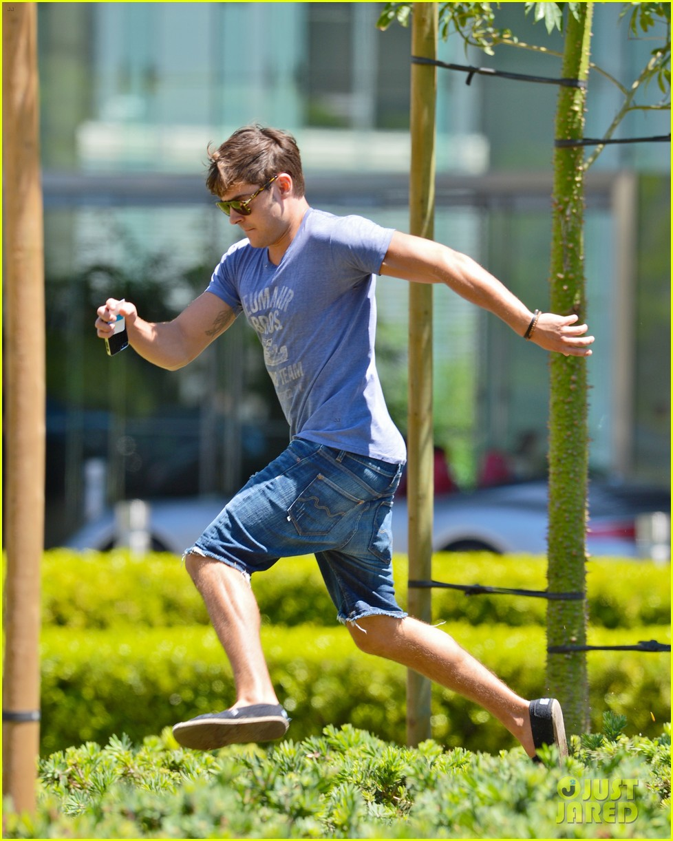 zac efron leaps into action for hotel entrance 04
