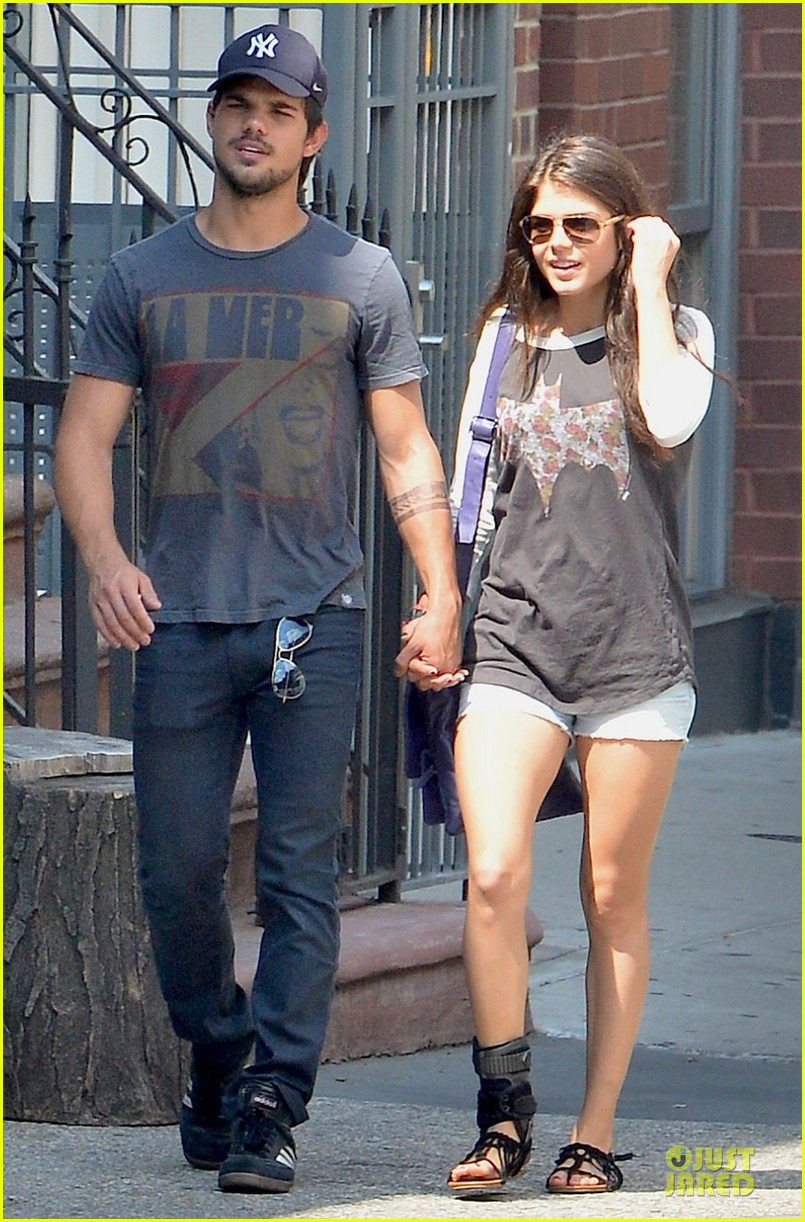 taylor lautner marie avgeropoulos holding hands as new couple 01