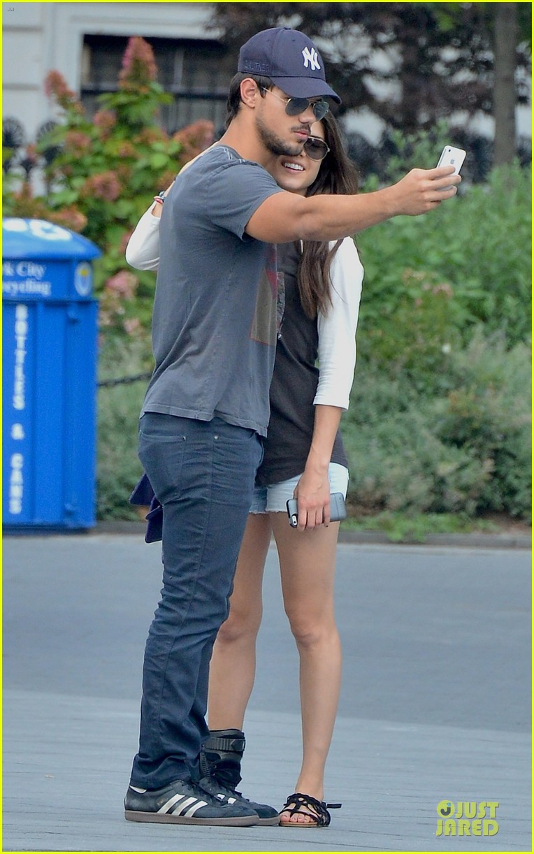 taylor lautner marie avgeropoulos holding hands as new couple 06
