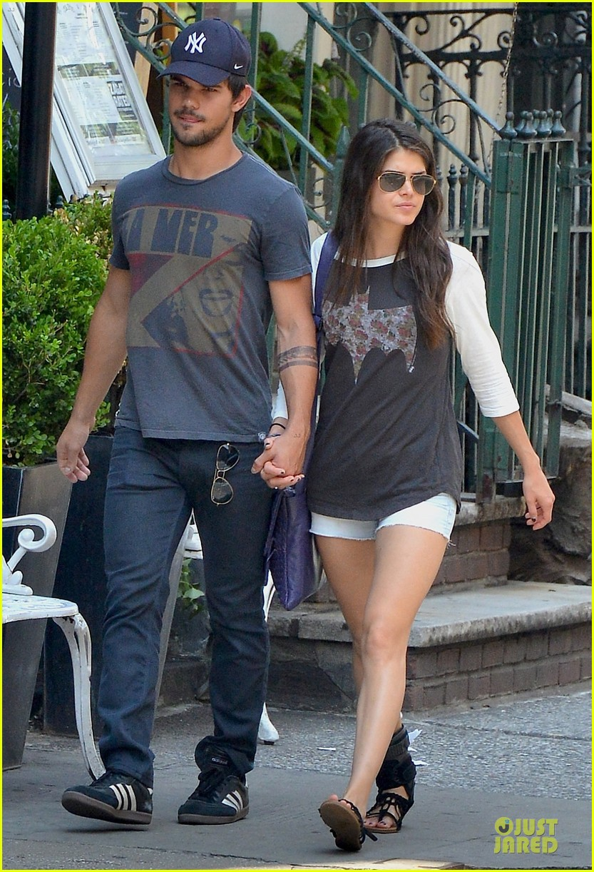 taylor lautner marie avgeropoulos holding hands as new couple 08