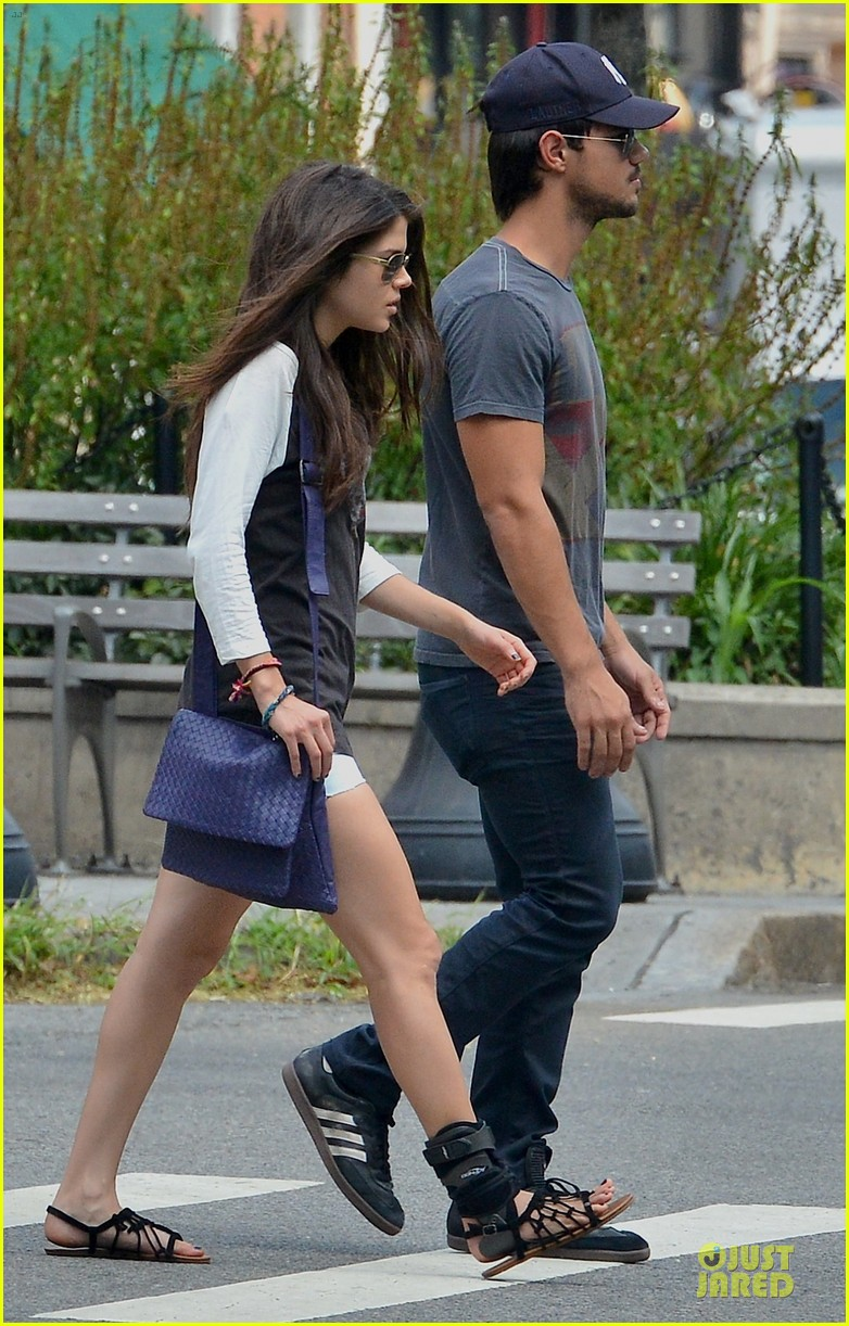 taylor lautner marie avgeropoulos holding hands as new couple 122919675