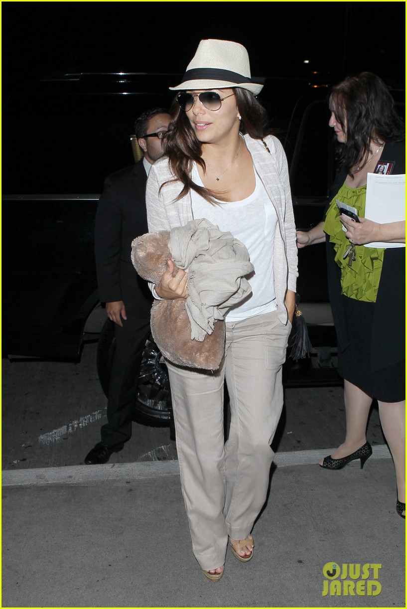 eva longoria lands in los angeles after paris trip 052908873