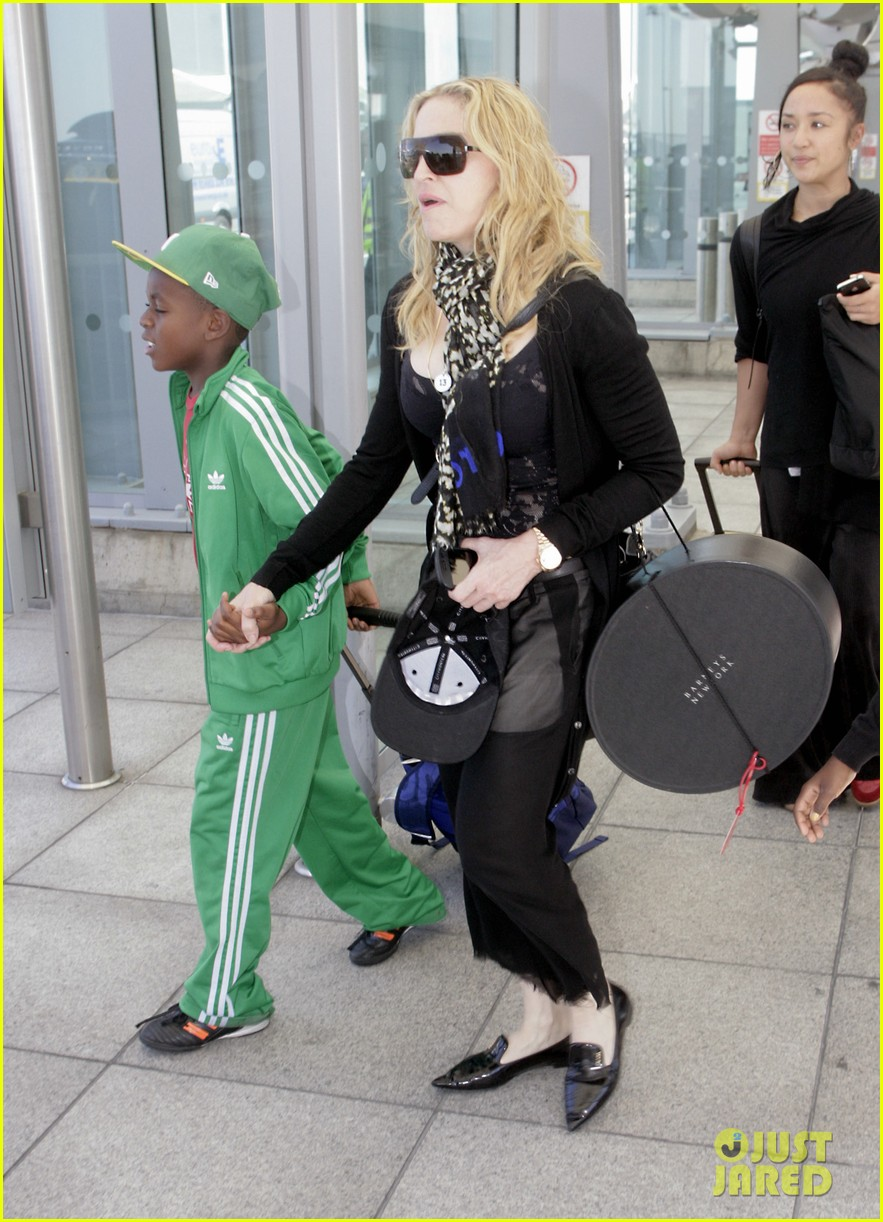 madonna lands in london with david mercy 01