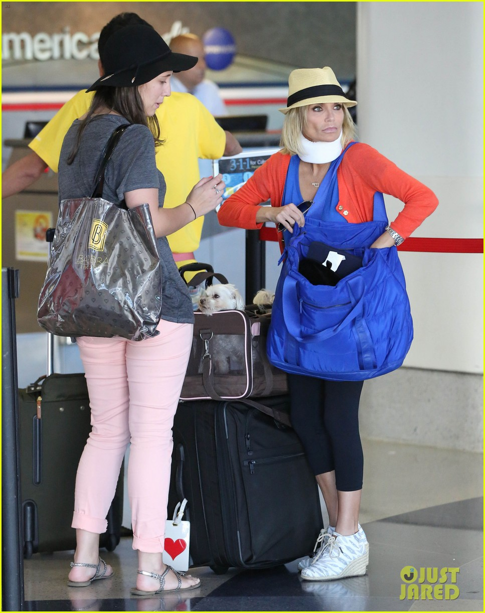 kristin chenoweth wears neck brace for flight to miami 03