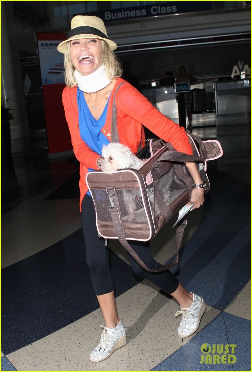 kristin chenoweth wears neck brace for flight to miami 15