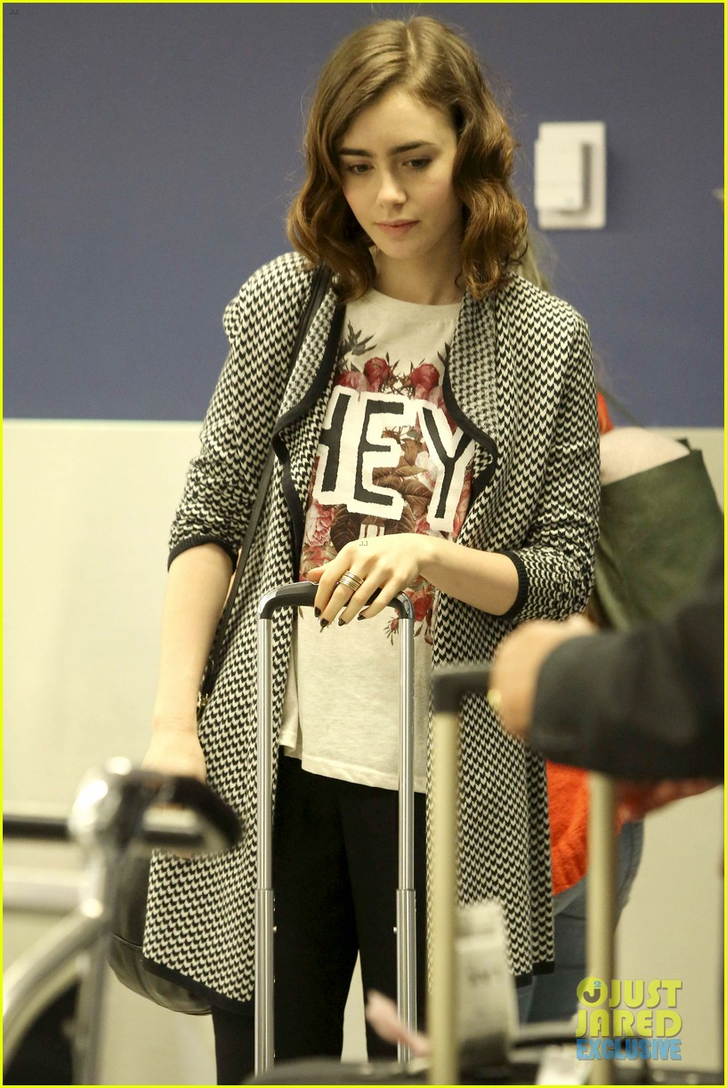 lily collins pushes giant luggage cart after mortals tour 13