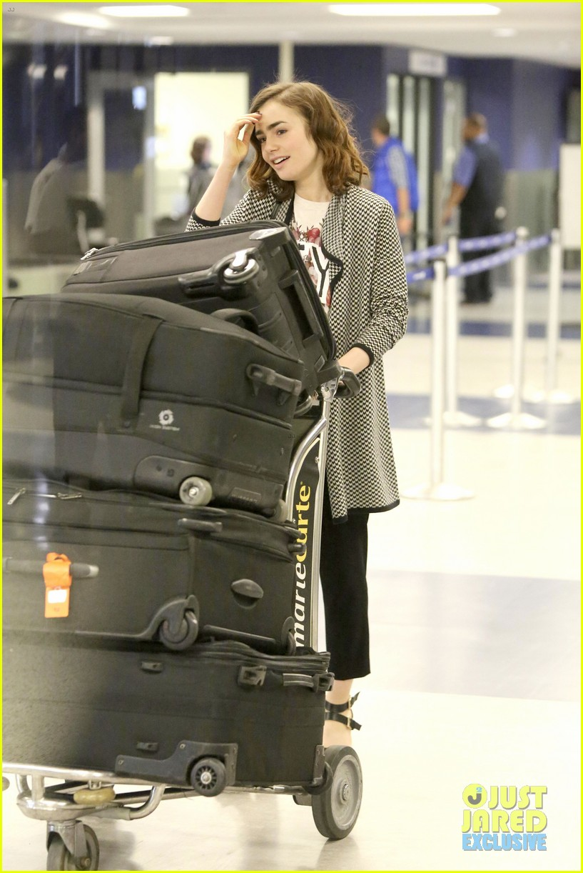 lily collins pushes giant luggage cart after mortals tour 172939618