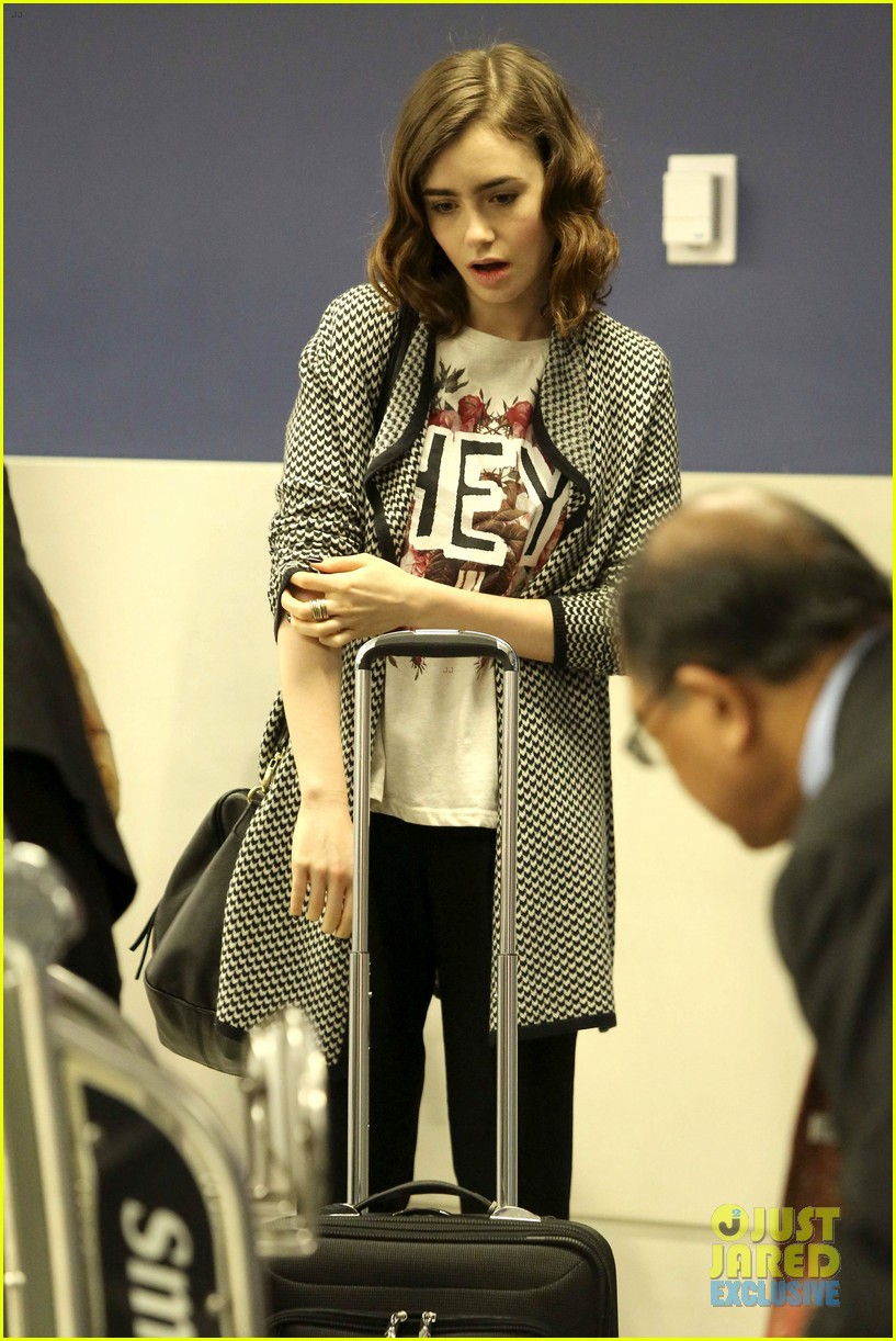 lily collins pushes giant luggage cart after mortals tour 20