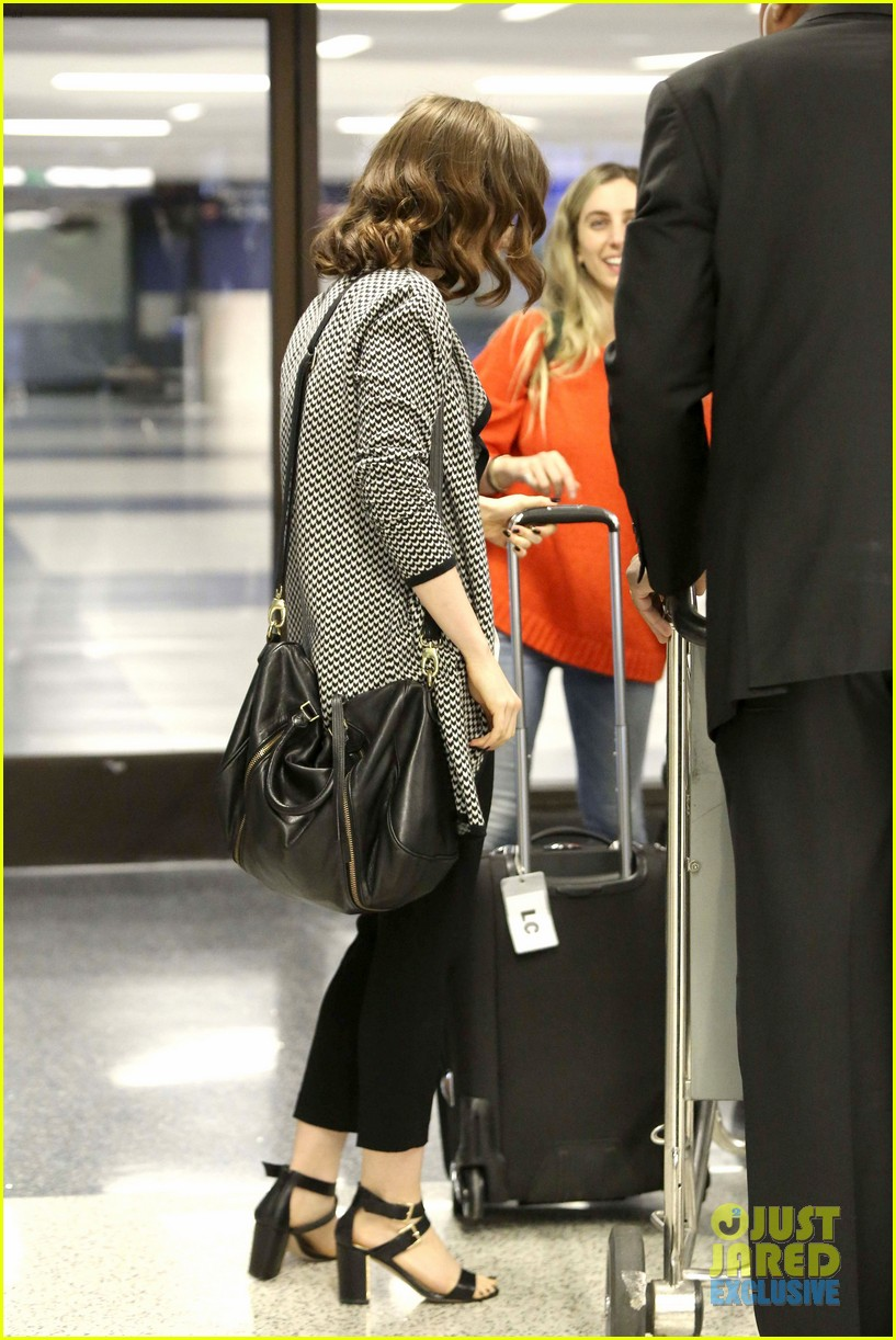 lily collins pushes giant luggage cart after mortals tour 272939628