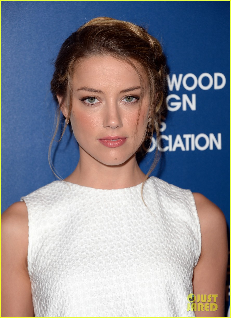 amber heard liam hemsworth hfpa installation luncheon 2013 122929520