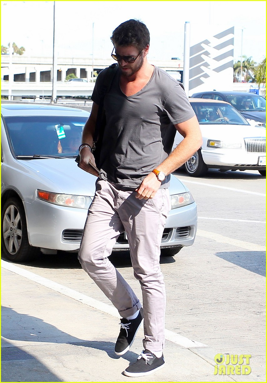 liam hemsworth takes flight miley cyrus sports tiny hair buns 132941111
