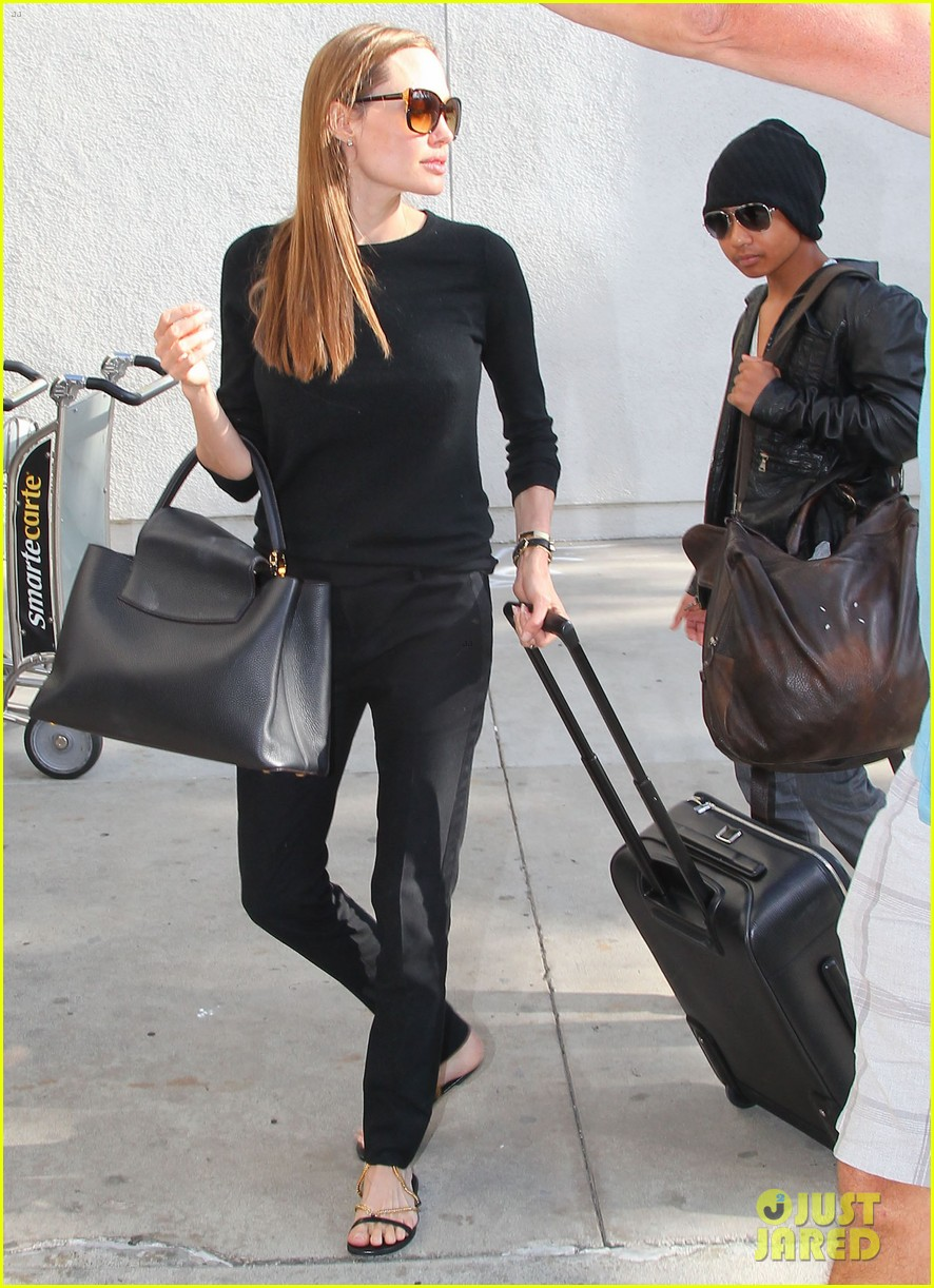 angelina jolie lands in los angeles with maddox 12
