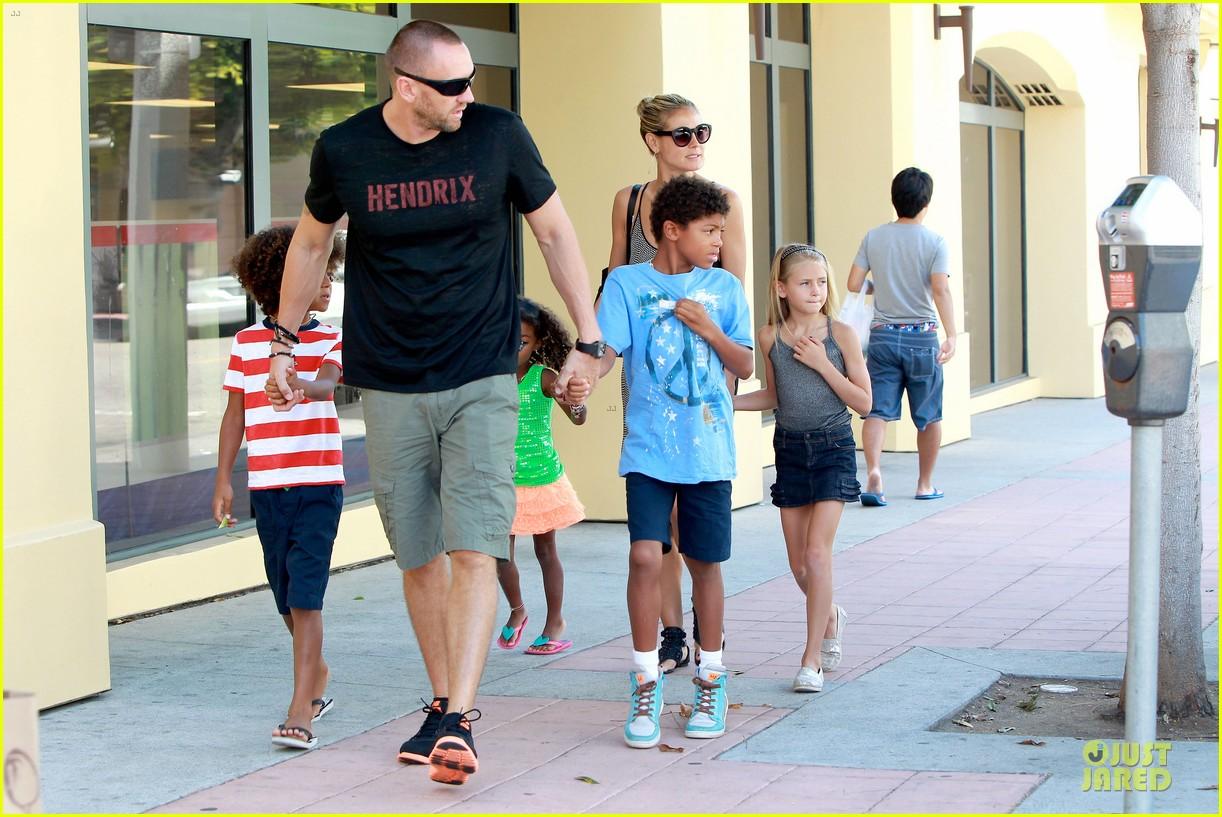 heidi klum martin kirsten beach bike ride with kids 252938459