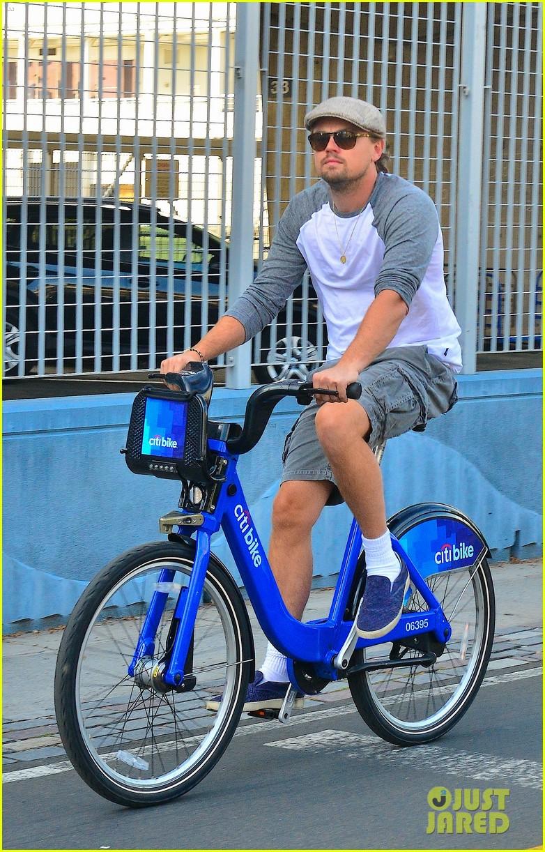 leonardo dicaprio rides a bike toni garrn parties for mademoiselle c 06