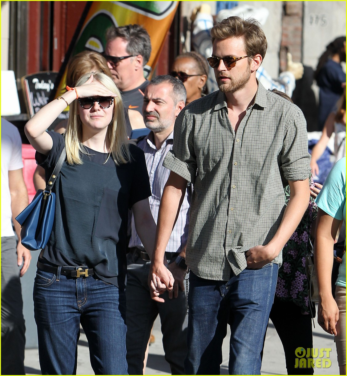 dakota fanning jamie strachan hold hands in new york 152943959