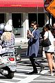 katie holmes snaps photo of vespa riding couple 07