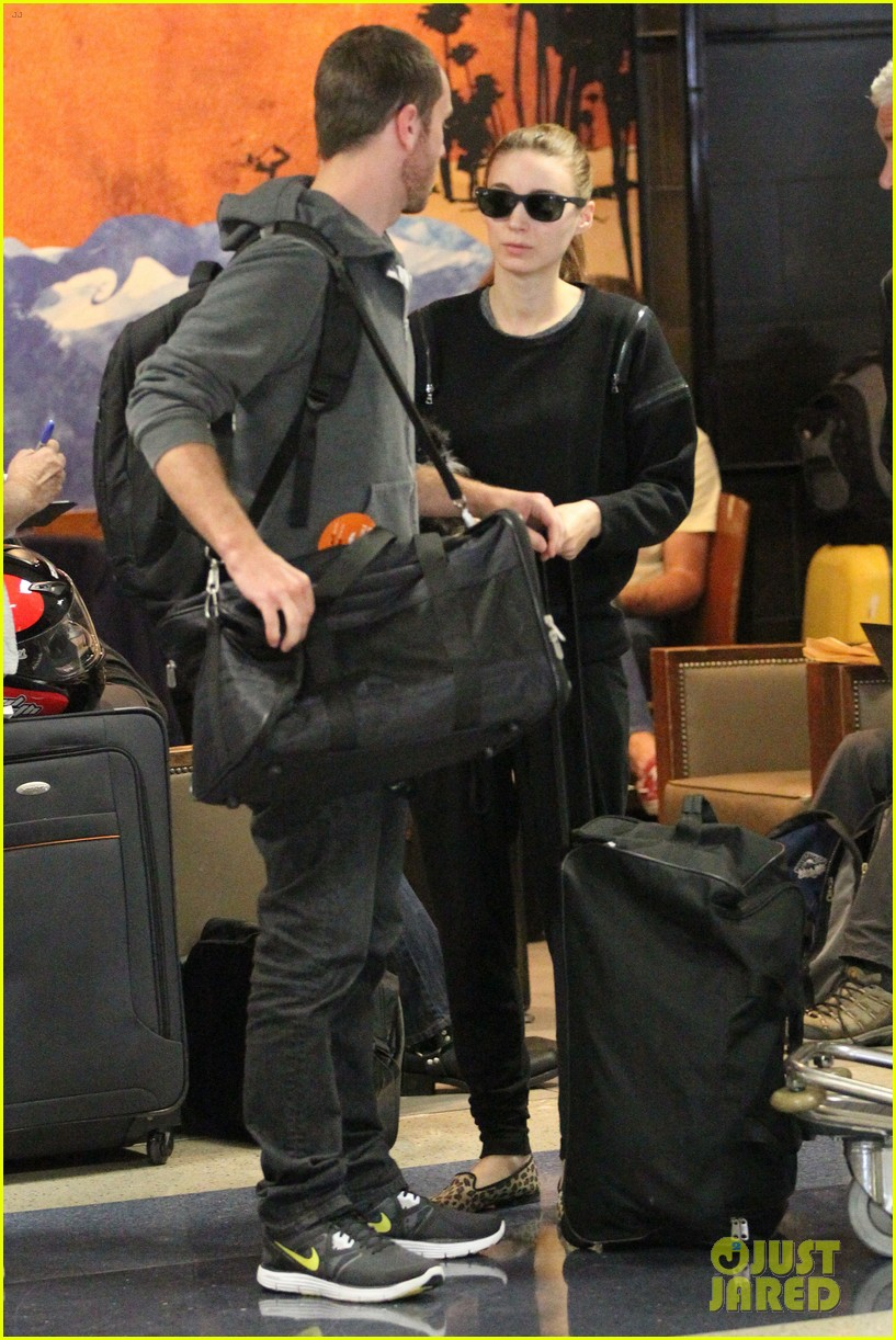rooney mara holds pet pooch close at the airport 06