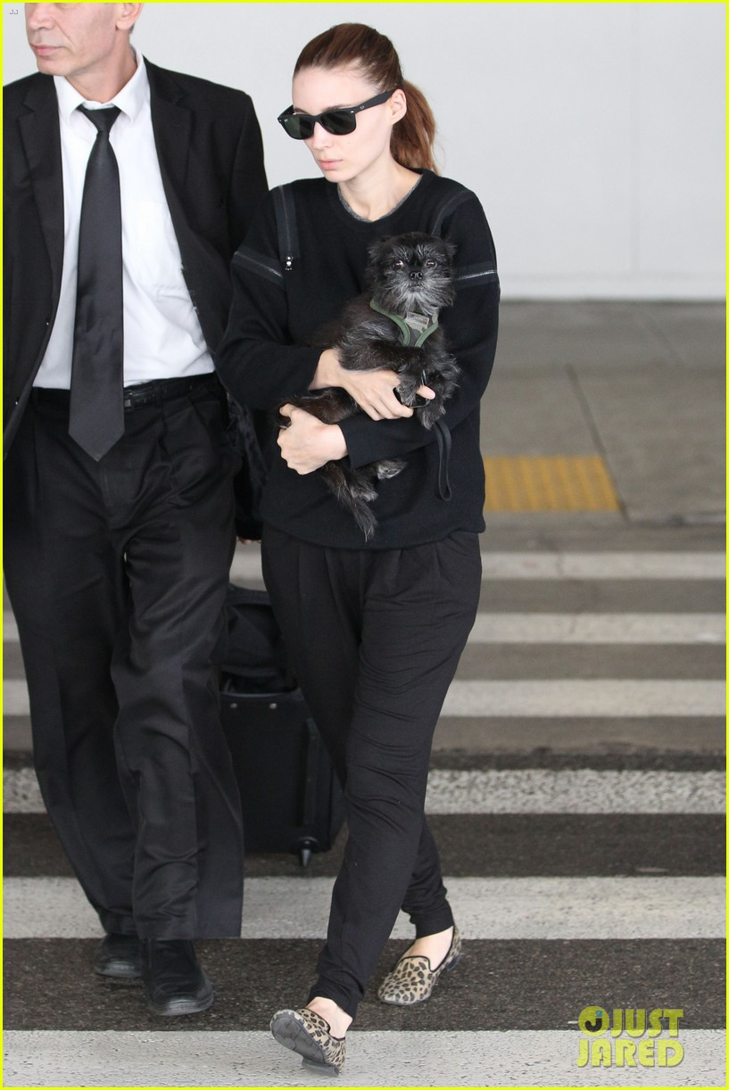 rooney mara holds pet pooch close at the airport 13