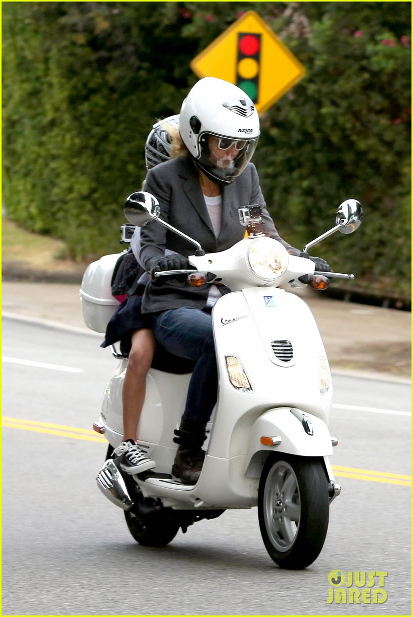 gwyneth paltrow chris martin side by side scooter rides 01