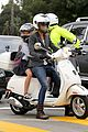 gwyneth paltrow chris martin side by side scooter rides 03