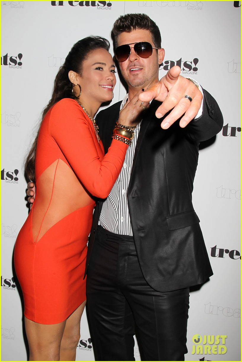 paula patton kisses robin thicke at his album release party 06