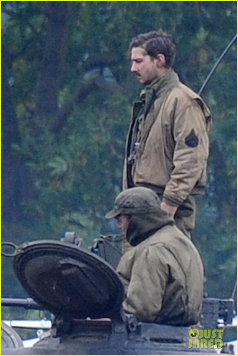 brad pitt rocks slicked back hair army outfit on fury set 05