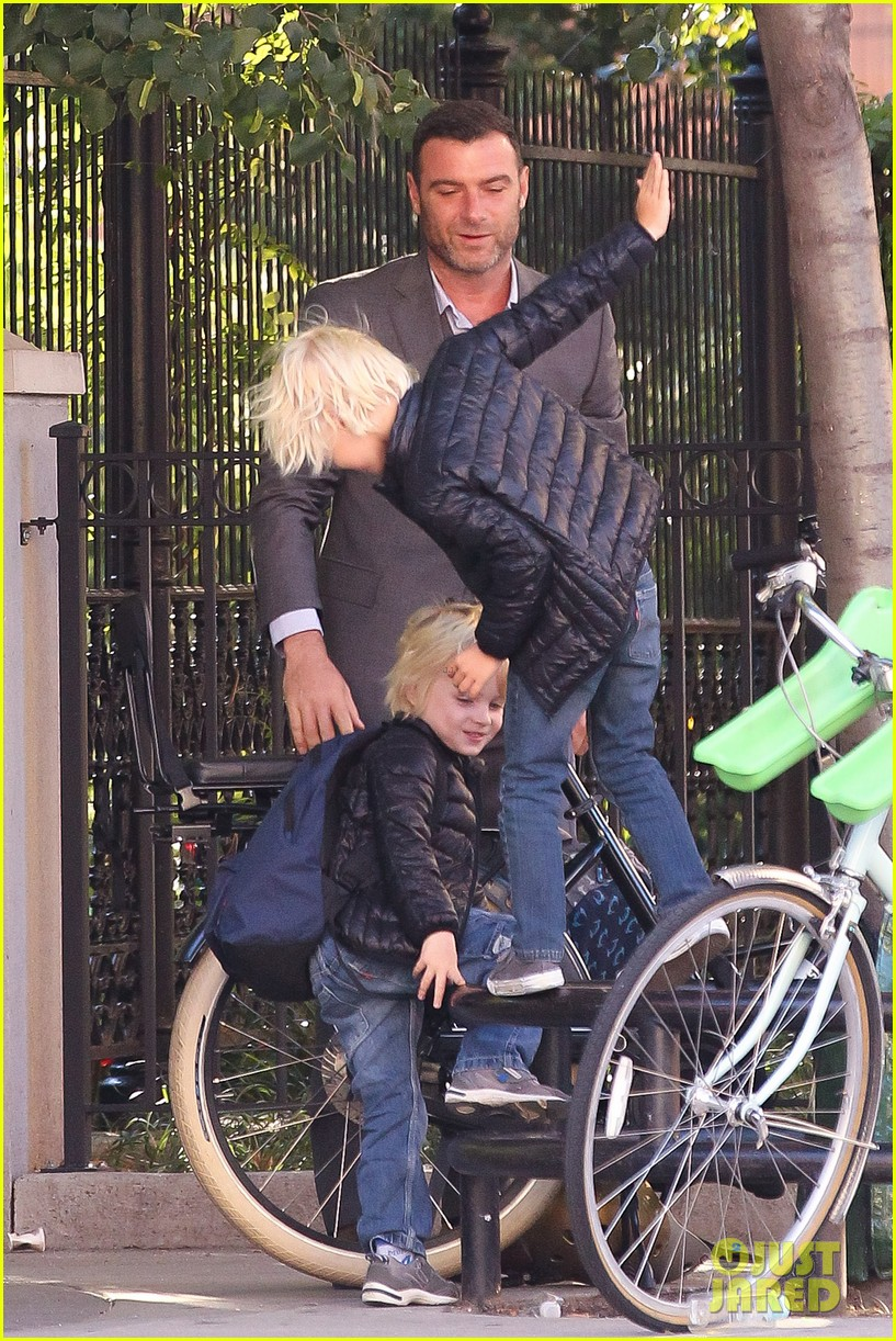 liev schreiber suits up for bike ride with his boys 172959092