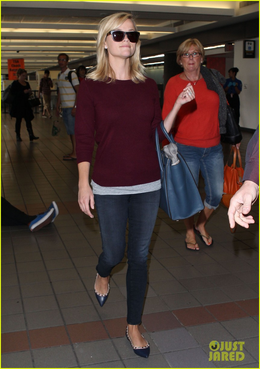 reese witherspoon hits lax after devil's knot tiff premiere 01