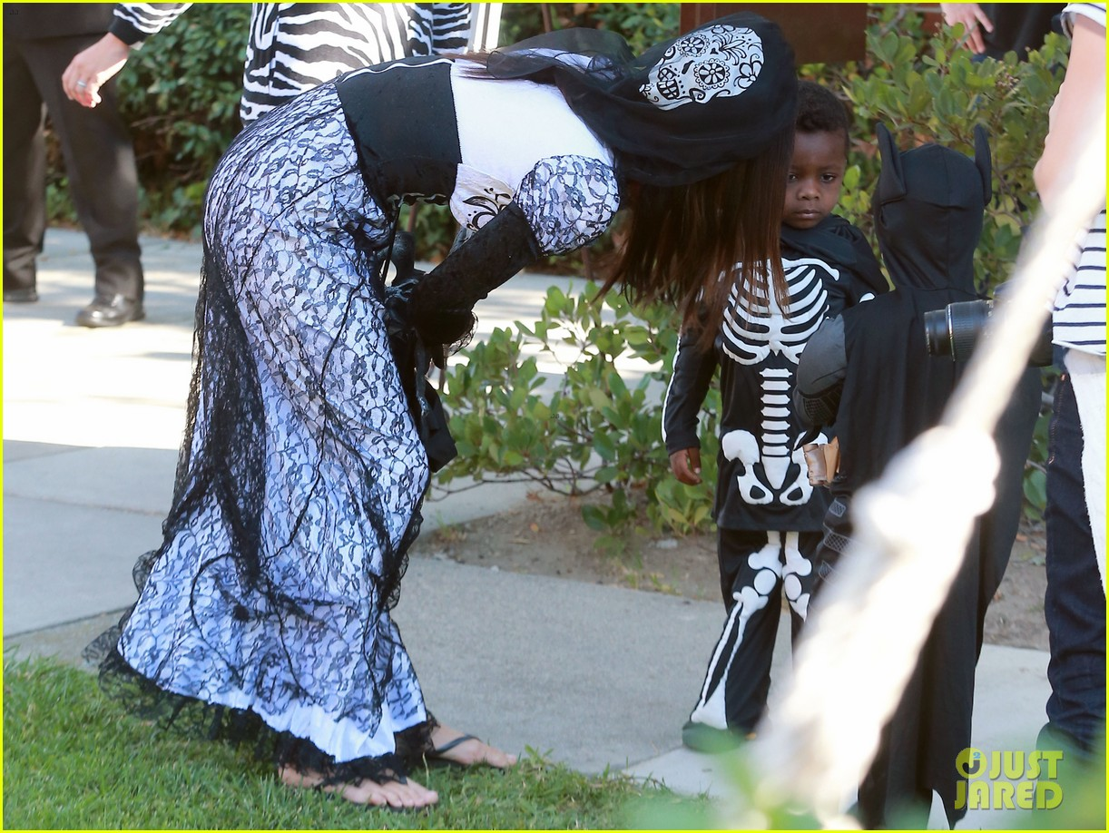 sandra bullock goes spooky for halloween party with louis 16