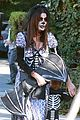 sandra bullock goes spooky for halloween party with louis 13