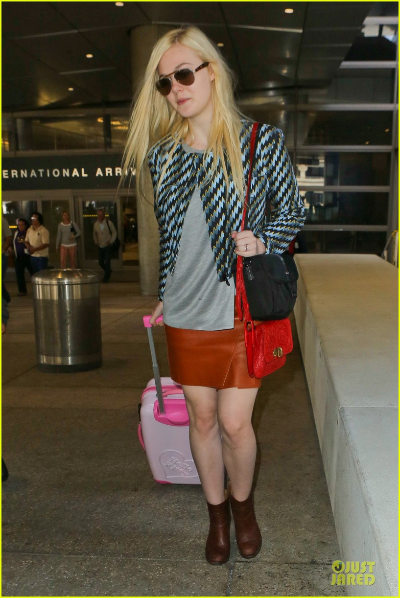 dakota fanning separate landings after paris fashion week 15