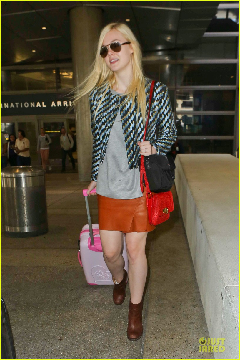 dakota fanning separate landings after paris fashion week 16