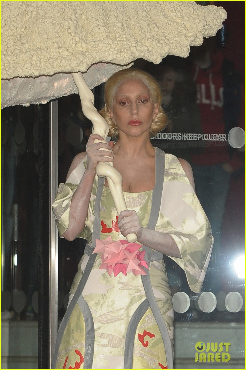 lady gaga carries large seashell umbrella around london 072983433