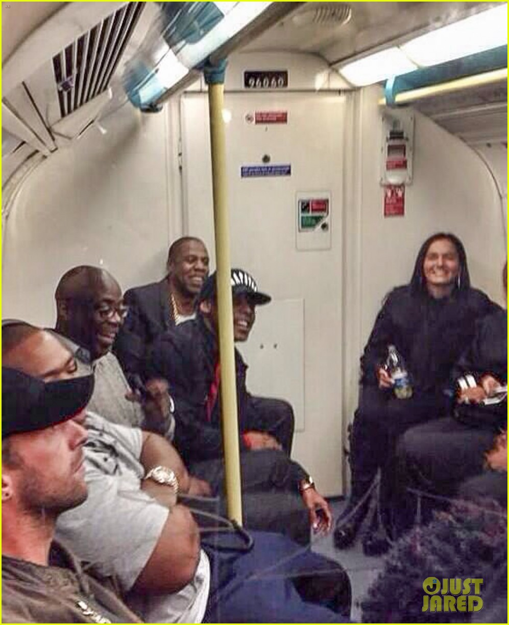 jay z chris martin ride tube to o2 arena. 04