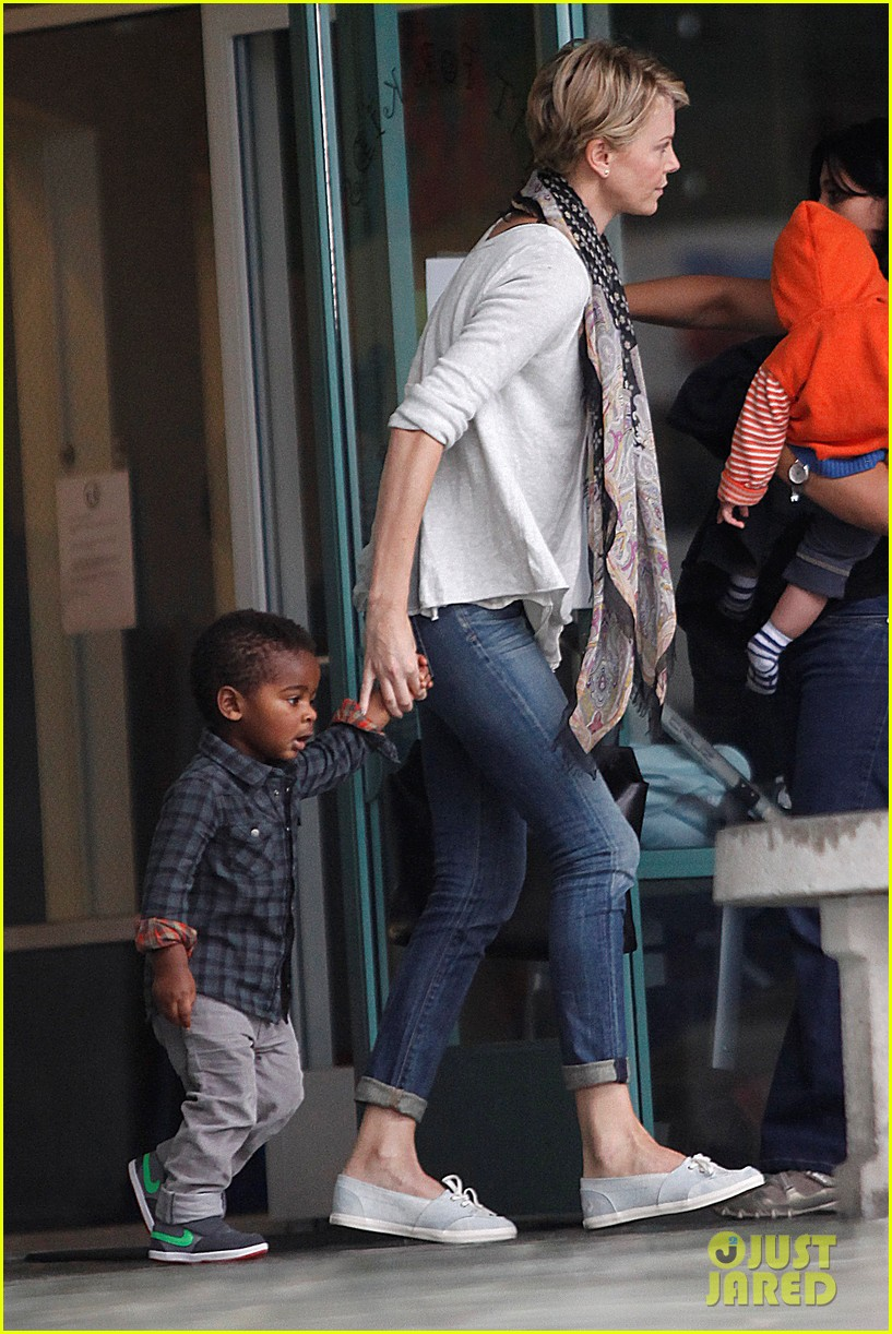 charlize theron holds on tight to son jackson 022969515