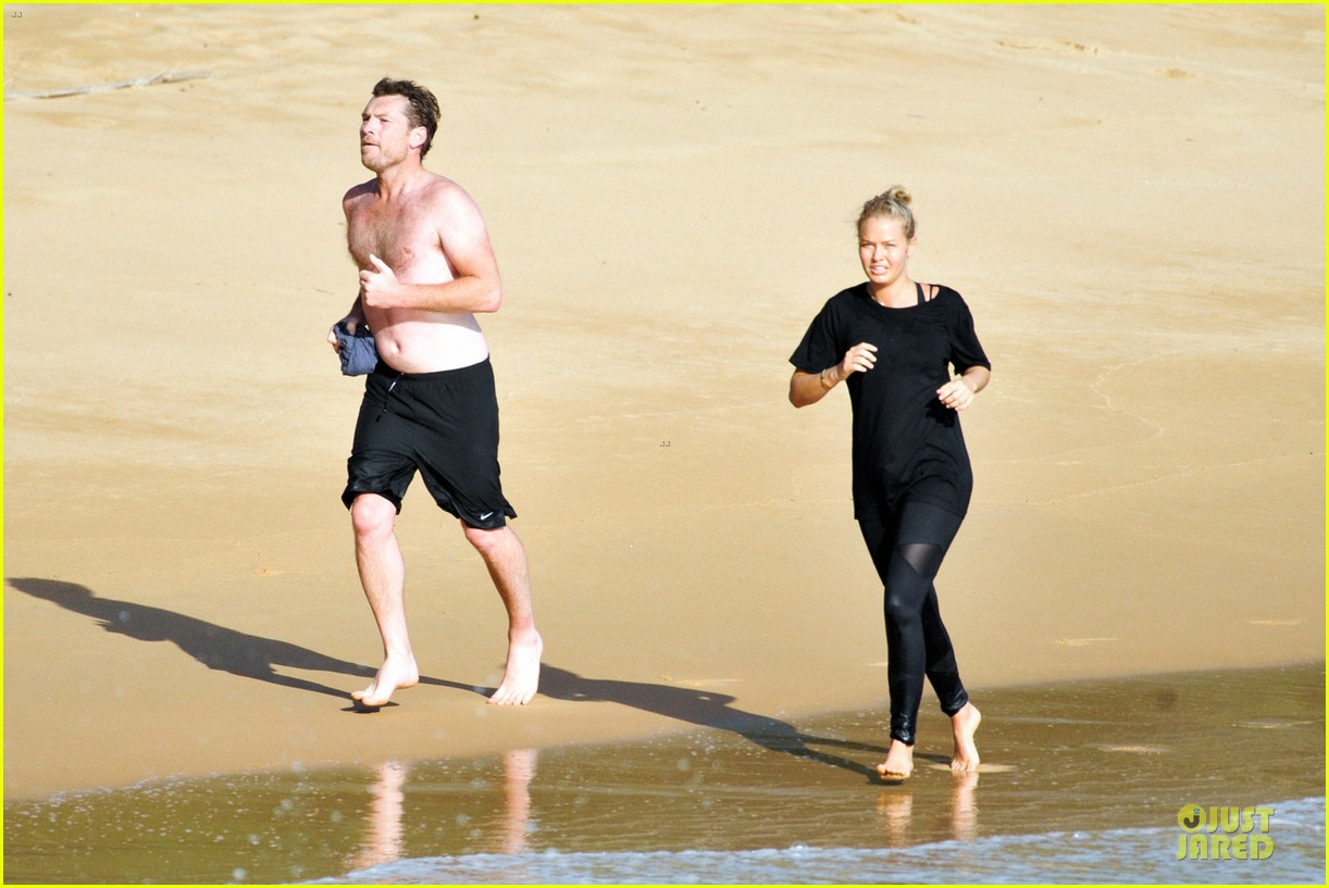 shirtless sam worthington laura bingle beach kissing couple 23