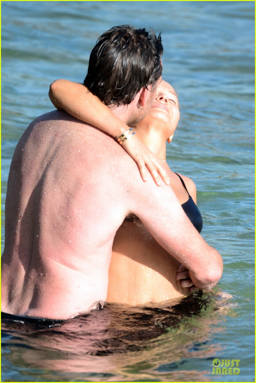 shirtless sam worthington laura bingle beach kissing couple 322969742