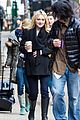 dakota fanning fake baby bump on fanny film set 09