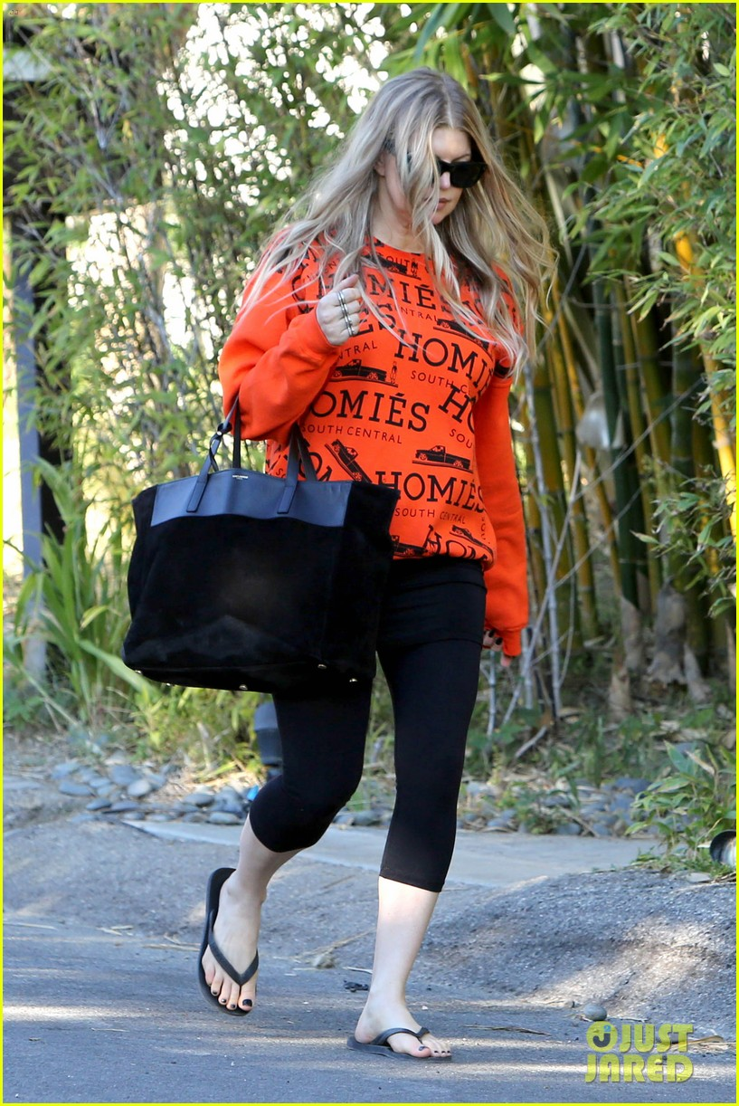 fergie halloween festive in orange sweatshirt 13