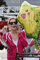 ashley greene leaves store with balloons party supplies 05