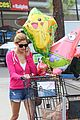 ashley greene leaves store with balloons party supplies 09