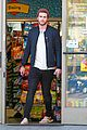 liam hemsworth steps out after catching fire breaks box office record 05