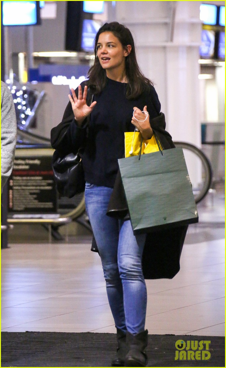 katie holmes arrives back in south africa 01