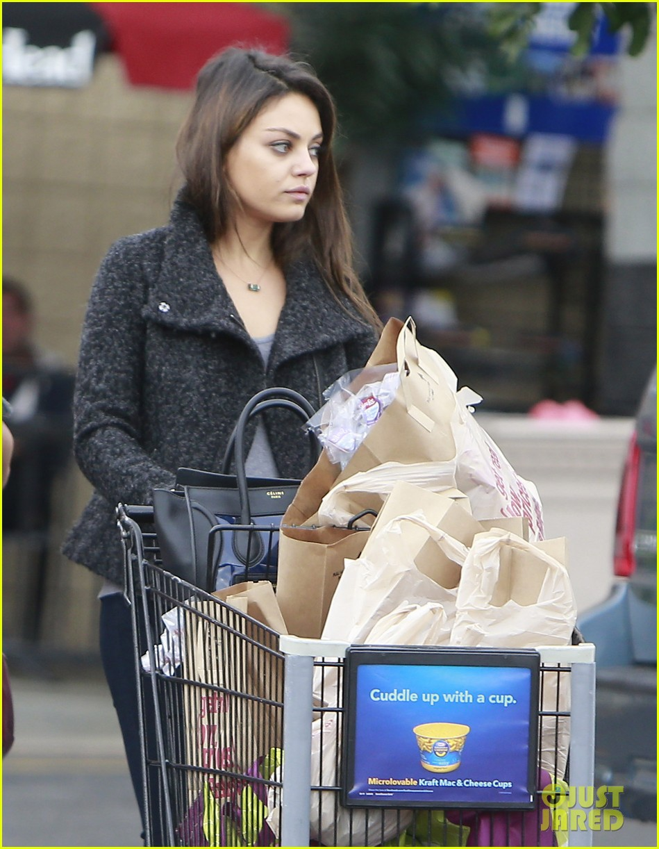 mila kunis shops amidst ashton kutchers walmart feud 142997299
